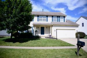 Exterior front w/shade tree, landscaping & extended driveway