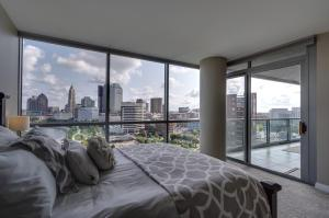 The bedroom has motorized honeycomb window shades that were added in 2018.