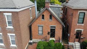 Fantastic location in the heart of German Village! This spacious brick cottage is near some of the neighborhood's best hot spots. Built with vernacular design in 1900, the home maintains much of the original character and has multiple additions and updates. This home is full of charm including handsome wood floors, beautiful moldings, built-in bookshelves, cabinetry fireplace mantel, high ceilings & great window placement with multiple  skylights allowing natural light to flood most rooms. First floor master (RARE IN GV!) Fantastic private back yard finished with paver brick for minimal yard maintenance, calming water feature and detached 1+ car garage. **Octoberfest themed Open House including live German music and food from Schmidt's restaurant Sunday September 22nd from 12-2pm!