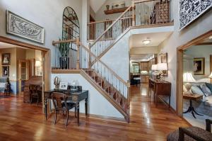 Soaring two story entry welcomes you home.