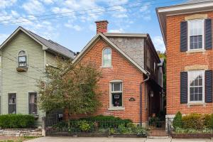 Sweetest of  Brick cottages that has been tweeked in all ways to make it ready to move into and enjoy! Centrally located, walking distance to everything German Village and features refinished original wood floor, exposed brick walls, updated kitchen with granite and stainless steel, 2.5 baths, totally landscaped  fenced yard and private patio areas, reworked 2 car garage plus more! Just delightful!