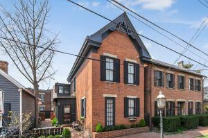 Stunning!! 3 story brick home in the heart of German Village. This 3 Bed, 3.5 Bath home is completely updated but still features that 1900's charm & historical detailing of exposed brick walls, high 12' ceilings and doorways accenting the beautiful original woodwork & crown moldings. The gorgeous kitchen is a designer's dream featuring high end SS Thermador appliances, an oversized marble island & brushed granite countertops! The large mud room including a first floor laundry was just elegantly remolded. You'll love the private 3rd level that offers a 3rd bed/office w/ a full bath. Step outside onto the private fenced-in brick patio, perfect for entertaining or walk to Schiller Park & the myriad of wonderful shops & restaurants in the German Village area. Plus a 2-car private driveway!