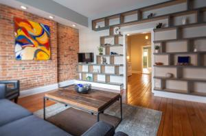 Gorgeous Half Double/ Shared Wall Condo in the heart of German Village.  Beautiful original brick interior walls and flooring, custom high-end shelving and high end finishes throughout.  The expansive private patio is the perfect place to entertain or hang out and enjoy some time on the hammock.  Condo boasts large bedroom with large closets and half bath on second level.  Walk outside the wrought iron gate and enjoy all that German Village has to offer- Grab lunch at The Brown Bag Deli or dinner or a drink at the countless places within a block's walk.  Unit also available for lease at $1,850 per month.