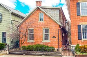 German Village, brick home with 2 car garage just a few short steps to Lindey's Restaurant. This home has so much character and charm with 2 spacious bedrooms, 2 1/2 updated baths, updated eat-in kitchen with granite counters, professional grade Thermador range, stainless appliances, multi-burner gas stove and so much storage space! Additionally there is a large living room, dining room and converted all-seasons room opens to the kitchen, private fenced brick patio with mature professional landscaping, Sonos sound system and more.  Showings start on Sunday January 26th.  Don't let this German Village gem slip away. See attached list of updates and mechanicals.