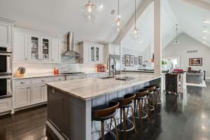 Fabulous executive home in the heart of GV was a complete renovation in '16 & featured on '17 Haus und Garten Tour. Spectacular spaces flooded w/tons of natural light in every room-this almost 3000SF home offers 1 floor living at its very finest & is tremendously unique. Ceilings are vaulted w/exposed beams, rich wood floors throughout, some exposed brick walls & most rooms open to amazing outdoor spaces w/lush gardens surrounding stone terraces. Finishes throughout are top quality: stunning kitchen w/huge island for entertaining, master is huge & opens to a private garden, 3 ensuite guest bedrooms + finished LL media room. Main living space has a wall of glass doors which open to the front gardens for exceptional entertaining. 3 car oversized garage. See A2A remarks.