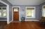 a front door opens into an inviting living/great room