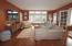 a nice size family room that opens into the screened porch