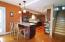a kitchen island dinette in the updated kitchen