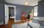 2nd bedroom with hard wood flooring