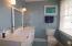 remodeled bathroom with new vanity sinks & tile flooring