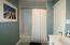 remodeled bathroom with new bathroom vanities & faucets and tile flooring