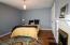 4th bedroom with hard wood flooring