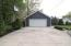 a concrete driveway from curb to garage