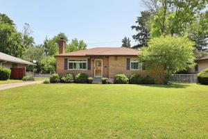 Mid Century Modern All Brick home w beautiful curb appeal