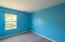 The 3rd bedroom features double door closet and overlooks the private backyard!