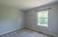 The 4th bedroom features double door closet and overlooks the private backyard!