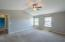 The master suite is complete with a ceiling fan/light combo and tons of natural light.