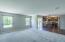 Spacious great room features overhead speakers.