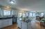 Light and bright kitchen with granite counters, tile backsplash and center island is open to the great room.