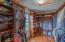 Professionally finished closet organizer and hardwood flooring in this HUGE walk-in closet!