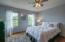 Hardwood flooring and overhead light/van combo.