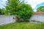 This backyard has it all! HUGE deck for entertaining, fire pit and fenced yard!