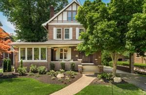 Beautiful brick home with large front porch and new front landscaping.