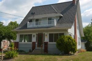 Welcome to your new home with an Inviting Enclosed Front Porch and Balcony!