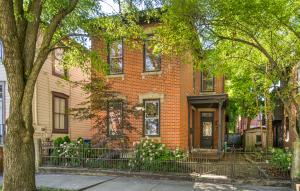 Great location just 2 blocks from Schiller Park in German Village-this classic brick italianate is filled with architectural detail blended beautifully with modern updates. Features include high ceilings, gorgeous original wood floors throughout, exposed brick walls and lovely woodwork painted crisp white. Both the kitchen and baths are stylish with great finishes executed with wonderful style! Both bedrooms are large, there is a huge walk-in closet, laundry is up and includes washer & dryer. Besides great front and back porches, this home has lovely gardens, brick patio and tons of privacy for outdoor entertaining. See A2A remarks.