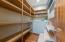 Walk in Pantry with pull out shelving steps to food prep areas