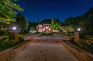 Stately all brick home, 1 acre, corner lot, Bates & Nau design has classic character & OPEN SPACE with many spectacular, extensive updates & additions. The perfect home to entertain includes parking for many. Five En-suites which includes a bonus teen, art studio or in-law suite.   Floor to ceiling windows provides views to fountain, patio, terrace &  fenced in yard. Gourmet kitchen, appliances by Subbzero, Thermador, Asko, cherry flooring, & cherry cabinetry, a walk-in pantry opens to casual eating area, sun room,& family rm. 1000 sq.ft. great room has fireplace & doors to patio. Beautiful, gleaming wood details though-out !  Winding stairs lead to 1200 bottle wine cellar, rec room has extra space for home office, home school, fitness rm., or crafts. OSU,& 315  minutes away.