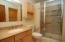 Completely updated full bath on the main level with plenty of storage.