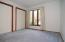 The second bedroom also features a large window and 2 closets.