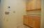 Also on the main level is a laundry room with abundant storage and space for stackable units.