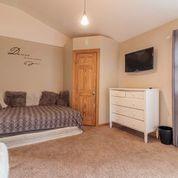 bedroom 2 with small balcony