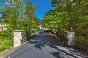 EXQUISITE PRIVATE GATED ESTATE W/ LARGE MAIN HOUSE, 9 GARAGE SPACES & SEPARATE CARRIAGE HOUSE W/ LUXURY APARTMENT! STUNNING PARK-LIKE PROPERTY CENTRALLY LOCATED ON OVER 4 ACRES OF BEAUTIFUL LAND, STAIR PATHWAY TO RAVINE W/ BEAUTIFUL STONE FORMATIONS, FEELS LIKE YOU ARE ON VACATION. THIS BOB WEBB-BUILT HOME HAS ALL THE EXTRAS INCLUDING A $150,000+ UPDATED CHEF'S KITCHEN, DINING ROOM, SUN ROOM, LARGE GREAT ROOM W/ WALL OF WINDOWS, 1ST FLOOR MASTER INCLUDING LUXURY BATH W/ HEATED TRAVERTINE FLOORS, TWO OFFICES (one could be a BR), THEATER ROOM W/ WET BAR, CRAFT ROOM, WINE CELLAR, EXERCISE ROOM & TWO EN-SUITE BEDROOMS UPSTAIRS.  THE OUTSIDE LIVING IS UNMATCHED W/PEACEFUL VIEWS ALL AROUND FROM THE PATIO, GAS FIRE PIT, HOT TUB & DECK AREA THAT IS FENCED FOR PETS! TRULY ONE OF A KIND!!!