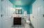 En-suite bathroom with walk-in closet