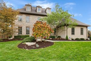 Elegant 'Country French' 5 bedroom, 4.5 bath home with full stone front. A dramatic foyer invites you into the open 1st level with gleaming hardwood floors. The home features elaborate crown molding throughout, granite counters, stainless steel appliances and a spacious office w/built-ins. Updates include 2 New HVAC units, gorgeous remodeled marble half bathl!  The lower level boasts a large family room with dramatic stone fireplace, kitchen/bar area, home theatre, game room, gym and craft room/kids' study, bedroom and full bath. New blue stone walkway, all new landscaping and landscape lighting. The picturesque backyard with a new custom cedar fence is perfect for outdoor entertaining, offering an expansive brick patio and stone WBFP with granite counter spac
