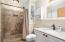 Remodeled owner's bath with beautiful tile shower & quartz countertops!