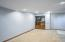 Finished basement area two. A great second living space featuring recessed lighting.