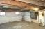 large basement with a lot of storage