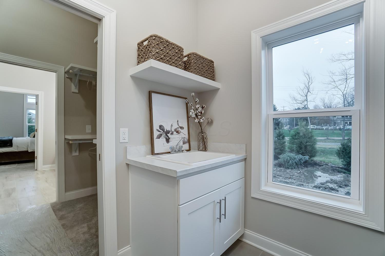 Laundry Room Attached to Master Suite