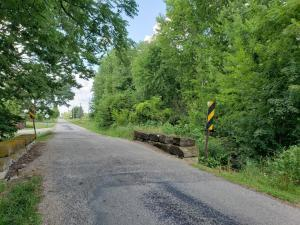 4+/- acre parcel to be sold is situated north of the one-lane bridge
