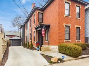 Spectacular renovation on a prime German Village street including Amish built addition adding 800+ sq ft of living space. Wonderful open concept main level with 10' ceilings, exposed brick walls, & designer touches. True formal dining room flows into a new custom kitchen with butlers pantry & spacious living room with bar. Enjoy a beautiful backyard oasis w/ unique private patio. 2nd level hosts an owners retreat with spa-like ensuite and oversized walk-in closet. Two additional large bedrooms, high-end guest bath and 2nd floor laundry. You never have to worry about parking with a 1 car garage and 5 off street driveway parking spaces. House also offers 2 office spaces on separate levels. Located close to restaurants, retail and more! See A2A remarks***