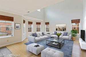 2 story great room. End unit with extra (replacement) windows and bamboo floors.