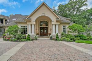 This custom home is in a prestigious and gated community, built by Paul Cugini for his own residence. Situated on a ravine lot with a picturesque view of the Olentangy River, allowing for a serene sitting in your own backyard. The lower level was designed with entertaining in mind and offers a full kitchen, wet bar, media room & game room. The patio has a bocce court and waterfall. Featuring a 2 story foyer, custom built-ins (including the closets), kitchen with a professional grade dual burner stove, custom cabinets, wet bar & wine cooler. For the car enthusiast, you will appreciate the 4 car garage with extra depth and a lower level 3 car garage, plus a work room. This home also has a separate, private 1300 SF suite with bedroom, living area, full kitchen, dining and bath. (agent/owne