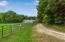 road to barns with fenced pasture