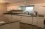 Kitchen has an abundance of cabinets, granite counters extra deep sink