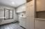 Sink and tremendous storage and built in laundry storage bins.