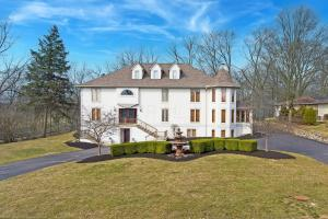 CUSTOM DESIGNED 3 STORY HOME W/FINEST OF QUALITY. OLD WORLD FRENCH CHATEAU W/SMART HOME INTEGRATION (CONTROL4) OVERLOOKS THE SCIOTO RIVER & BACKS TO WOODED RAVINE W/CREEK. ENJOY THE MAGNIFICENT VIEWS FROM THE HUGE DECK WHICH WRAPS AROUND THE BACK OF THE HOME. THIS IS TRULY A ONE OF A KIND HOME JUST UNDERWENT AN EXTENSIVE RENOVATION (~$350K) FEATURES FILTERED WATER, A 5 FT GALLEY SINK SUBZERO/WOLF APPLIANCES & IMPORTED ITALIAN MARBLE FIREPLACE. IT HAS TWO MOTORIZED HIDDEN DOORS WITH A CONTROL4 HOME AUTOMATION SYSTEM WHICH CONTROLS THE LIGHTING, VIDEO INTERCOMS, THERMOSTAT, FIREPLACE & MANY OTHER FEATURES. HVAC REPLACED & DUCT WORK REDONE WITH A 4 ZONE DAMPER SYSTEM INSTALLED. HOUSE HAS A LRGE OFFICE. FULL, FNSD WALK-OUT LL WITH BILLIARD RM, HOME THEATER SYS WIRED FOR 5 TVS, 2 REC RMS & BATH